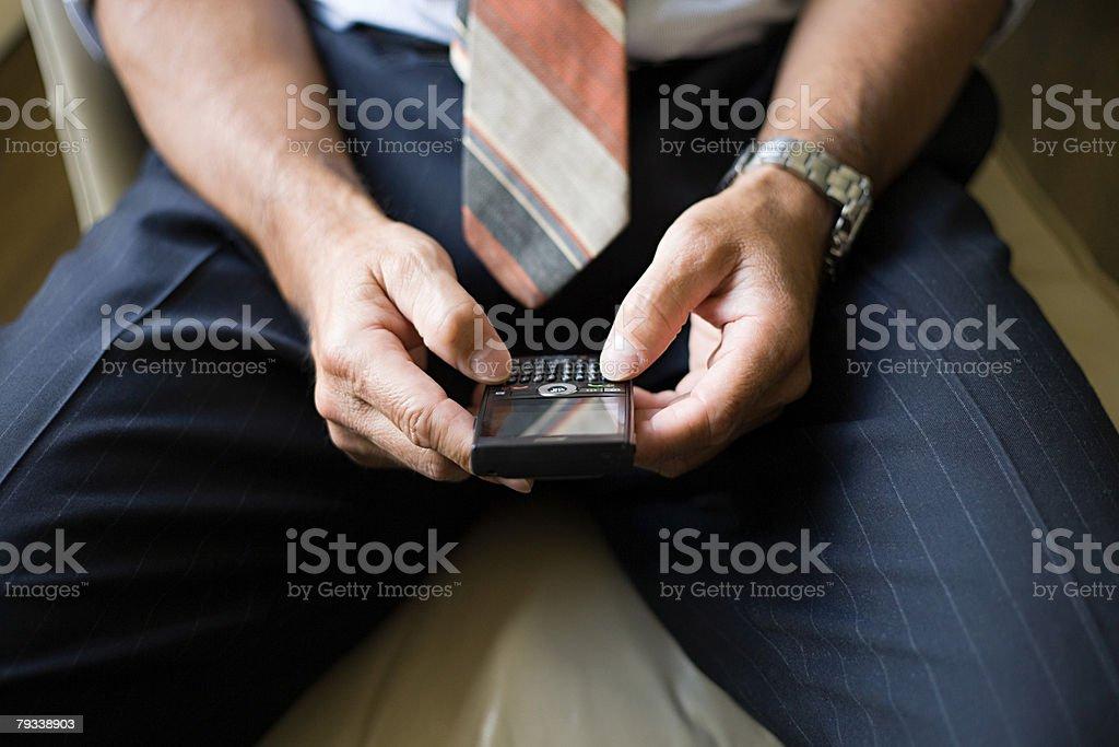 Man with handheld computer stock photo