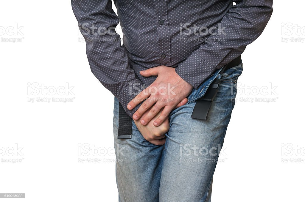 Man with hands holding his crotch, incontinence stock photo