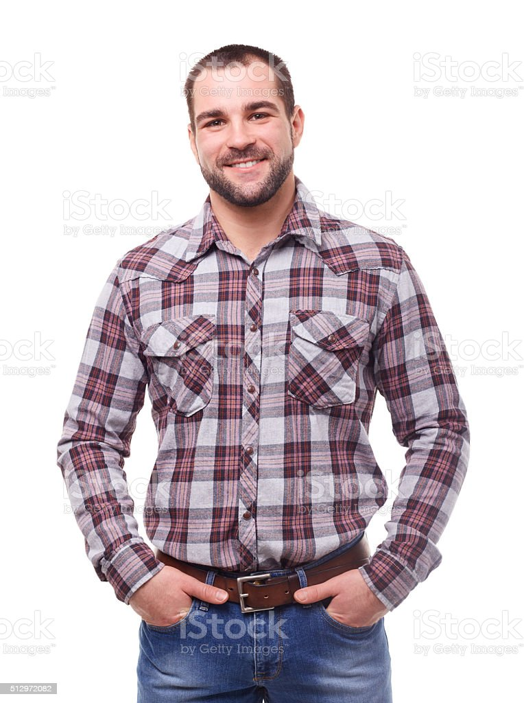 Man with hands in pockets stock photo