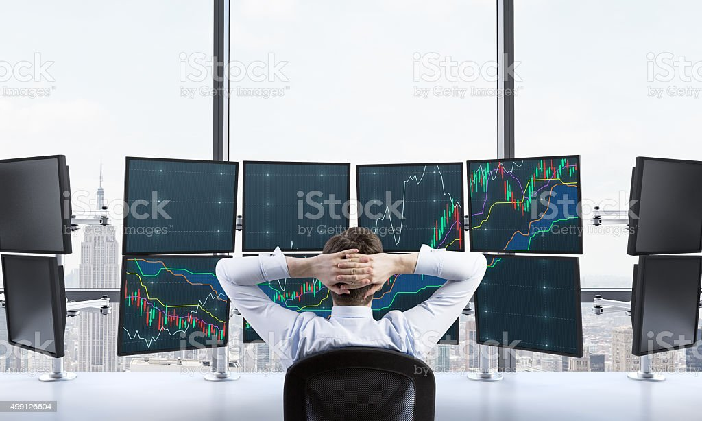 man with hands locked on back of the head sitting stock photo