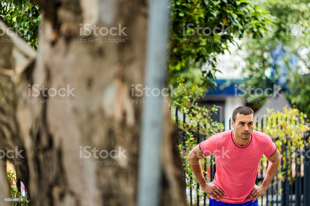 Man with hands on hips looking away stock photo