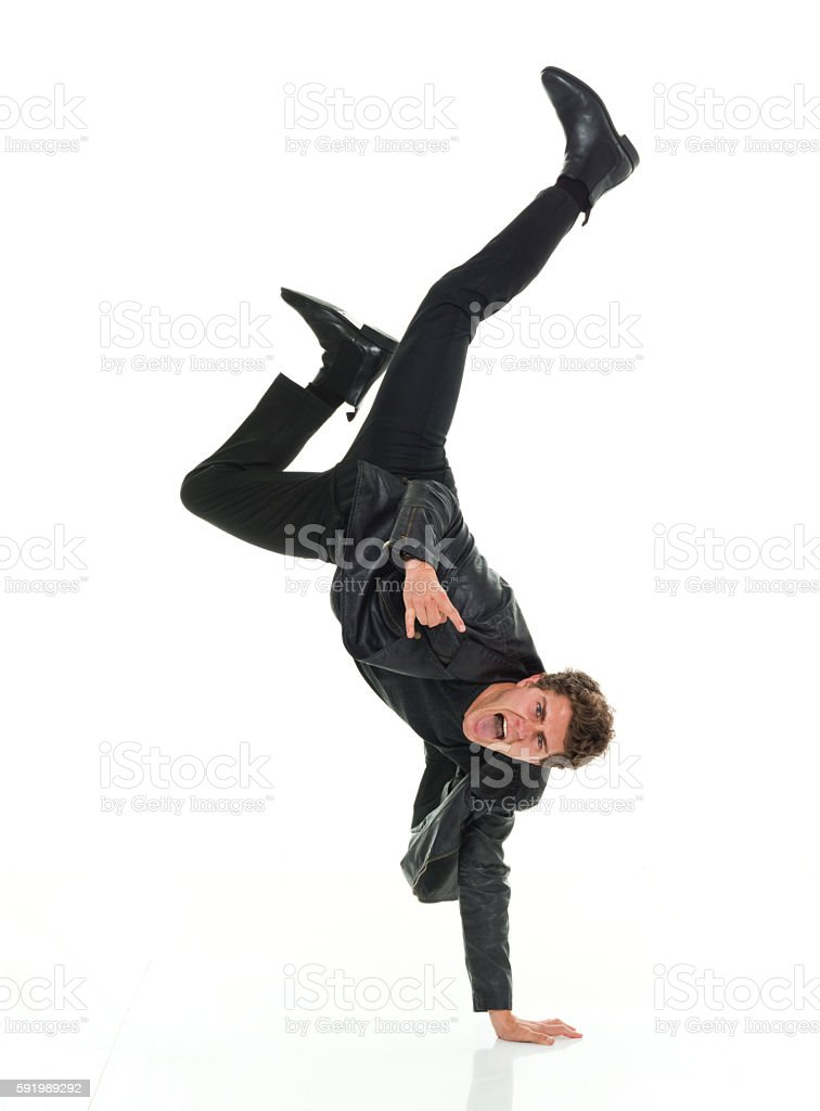 Man with handstand and giving shaka sign stock photo