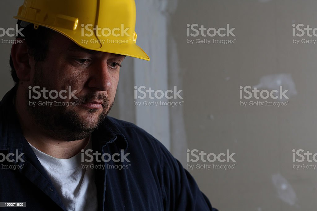Man with hard hat doing construction stock photo