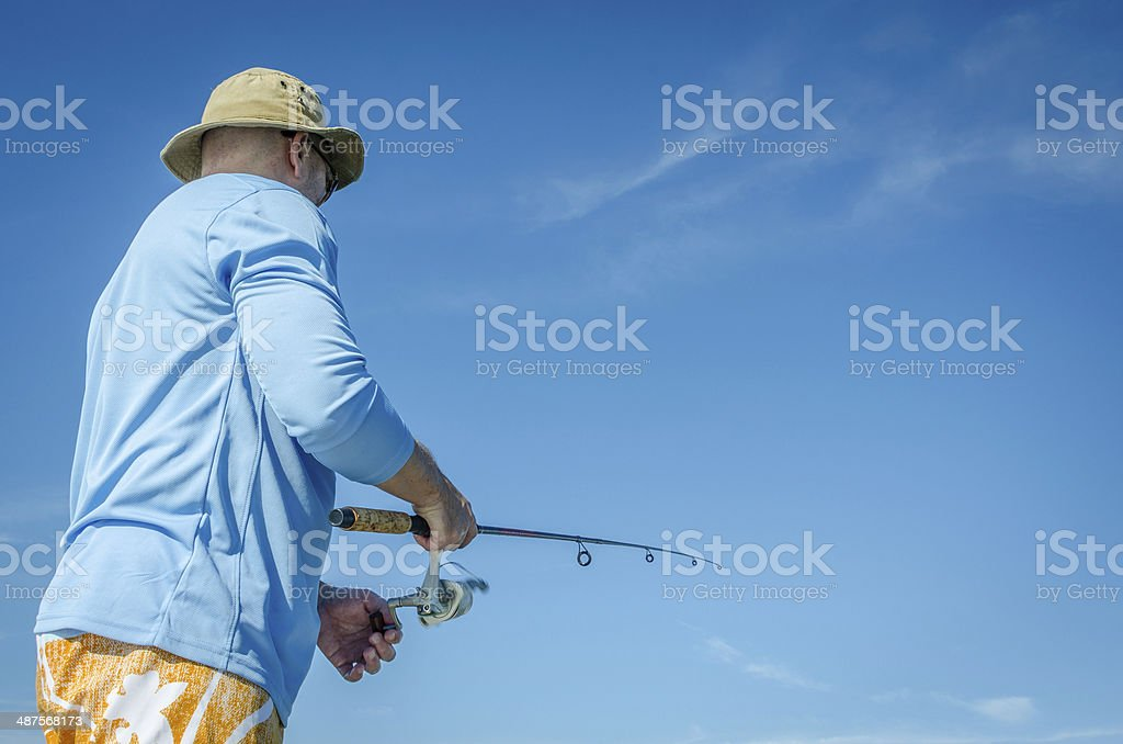 Man with hat fishing stock photo