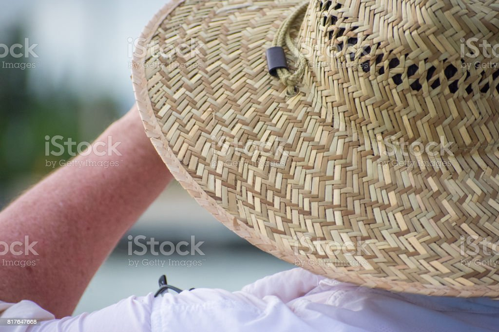 Man with hat on beach stock photo