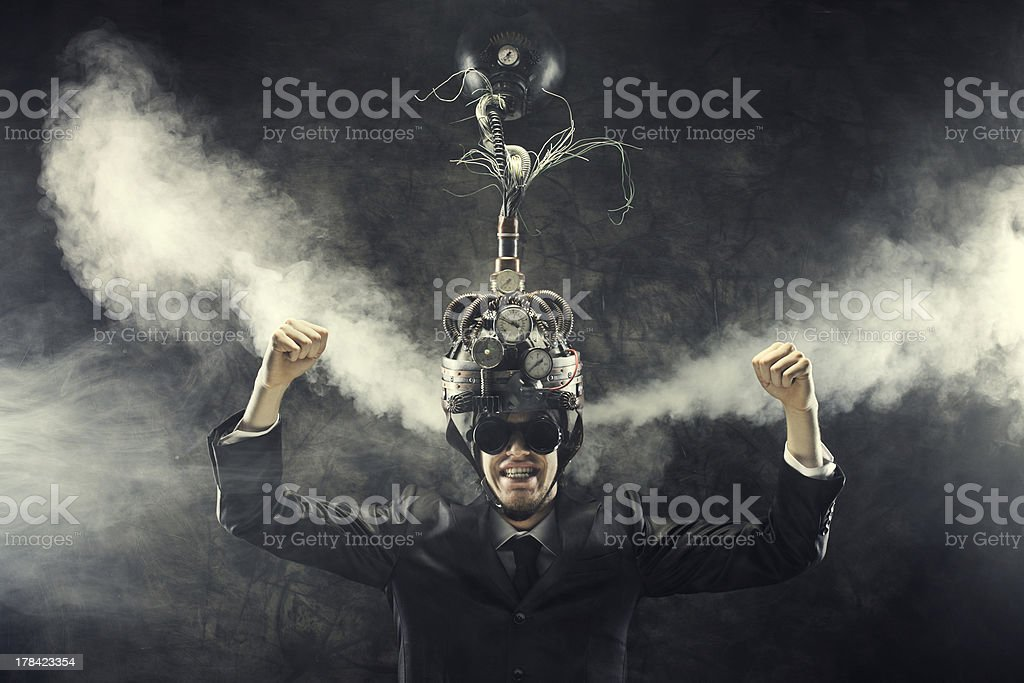Man with head apparatus demonstrating concept of success stock photo