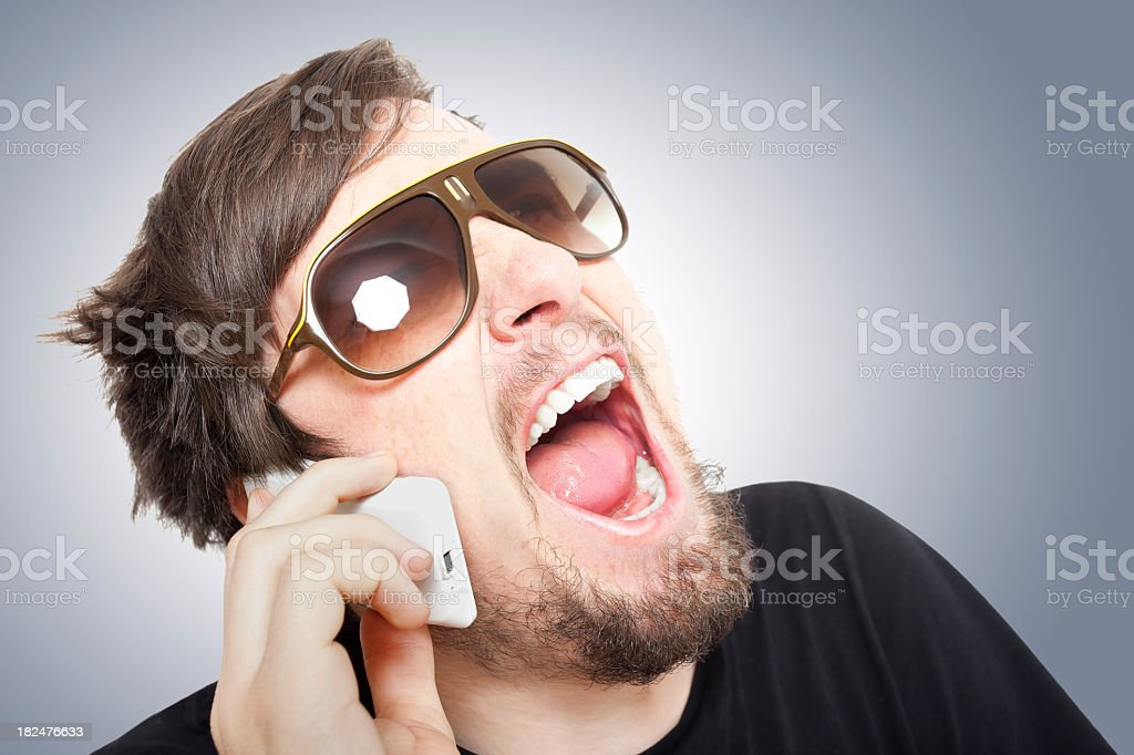 Man with head back and mouth open wearing sunglasses royalty-free stock photo