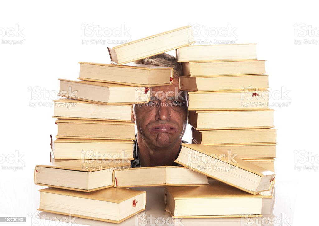 man with head between books royalty-free stock photo