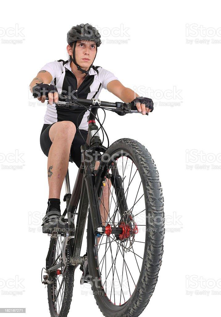 Man with head gear riding on mountain bike stock photo