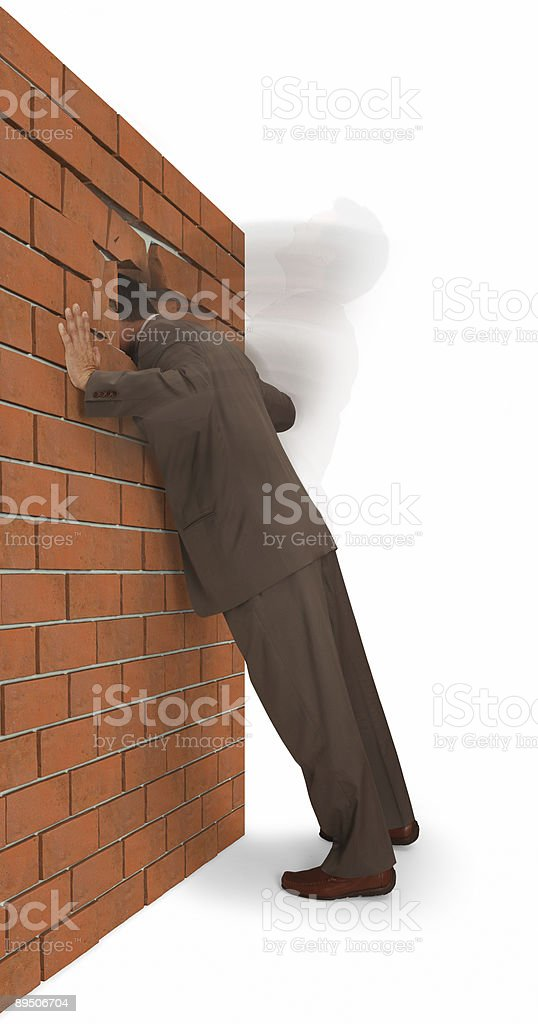Man with head inside brick wall representing frustration royalty-free stock photo