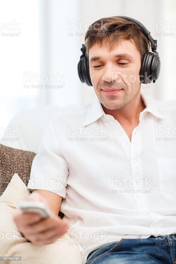 man with headphones and smartphone listening to music stock photo