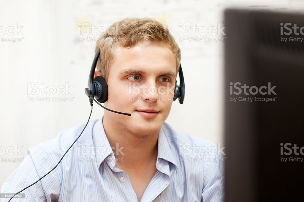 Man with headset next to the monitor royalty-free stock photo