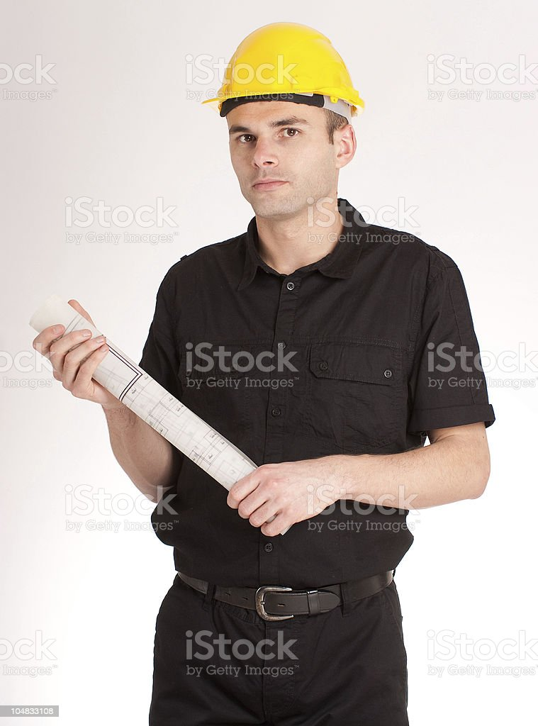 Man with helmet and blueprints royalty-free stock photo