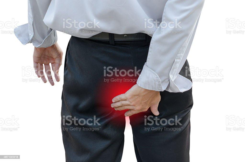 Man with hemorrhoids stock photo