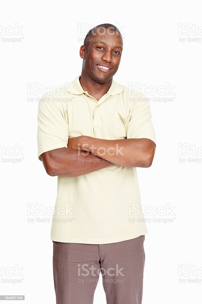 A man with his arms crossed in front of his chest royalty-free stock photo