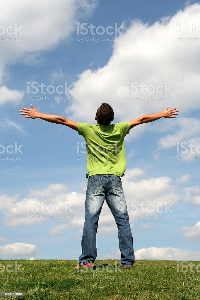 Man with his arms wide open royalty-free stock photo