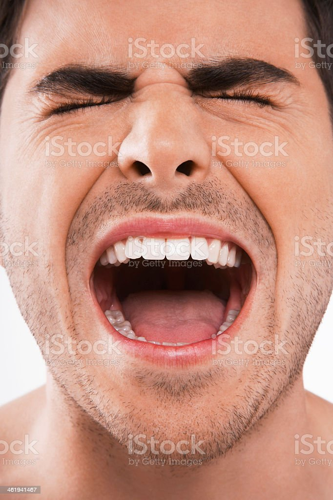 Man with his eyes closed screaming loudly stock photo