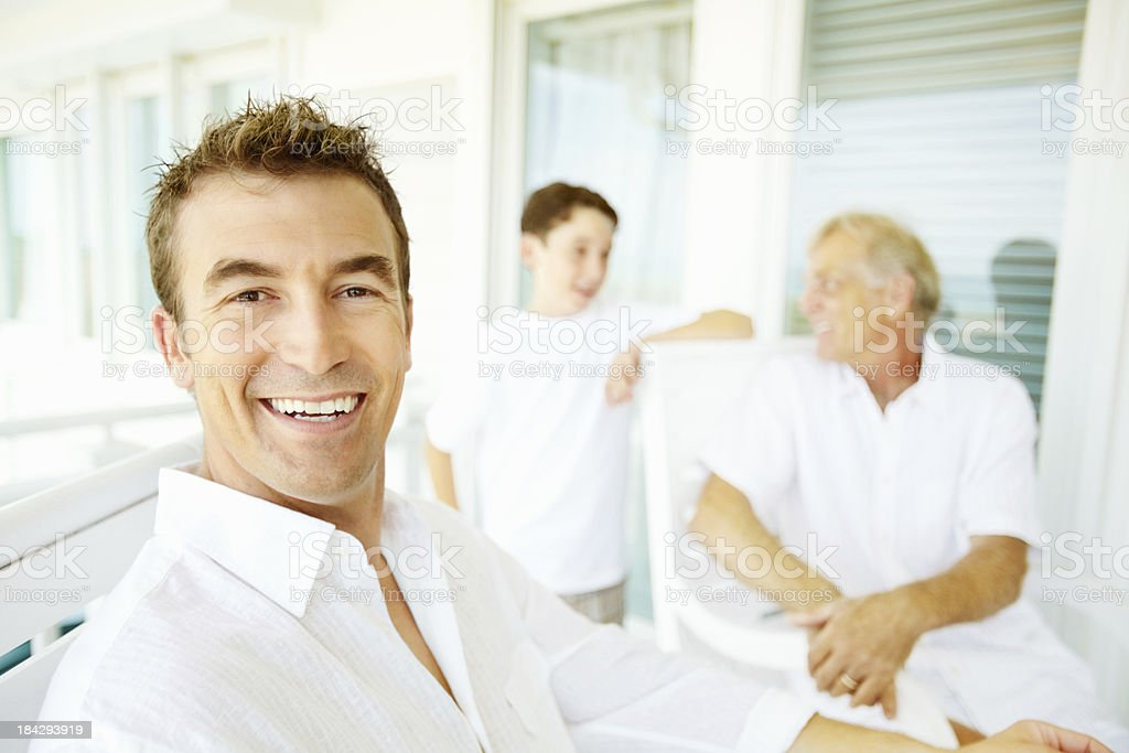 Man with his family on porch royalty-free stock photo