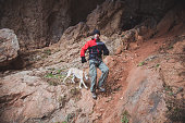 Man with his labrador dog hike in a cave.