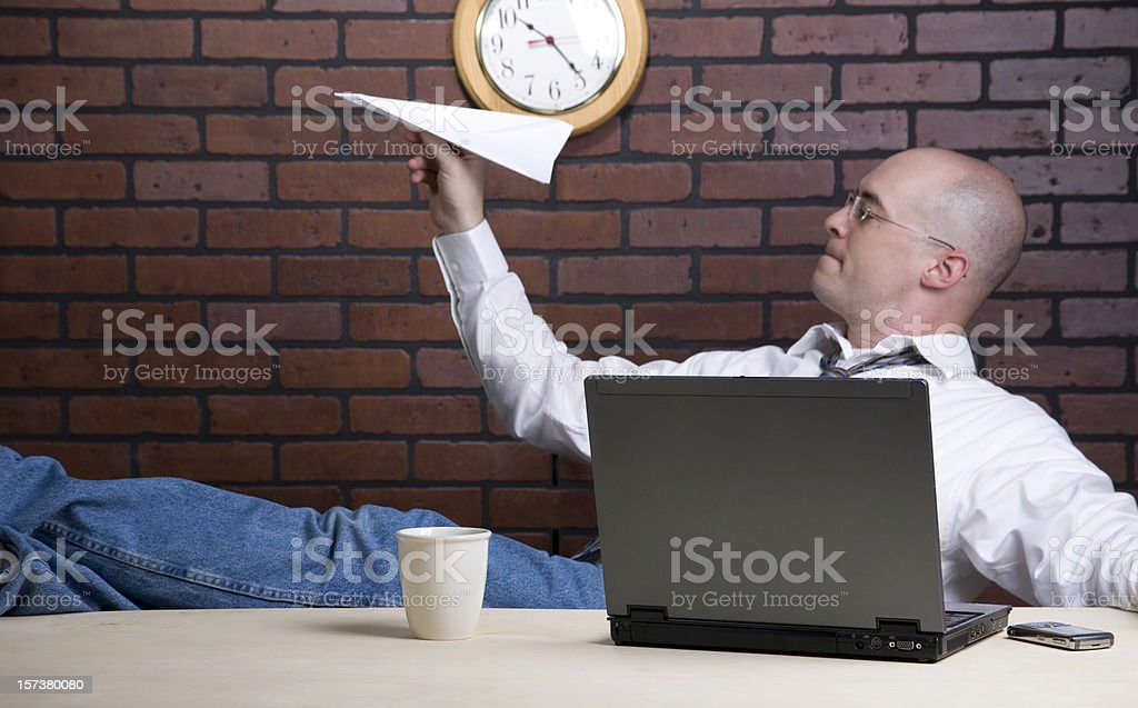 A man with his laptop and coffee cup stock photo