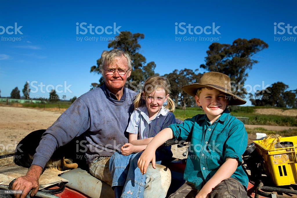 Man with his son and daughter in the country stock photo