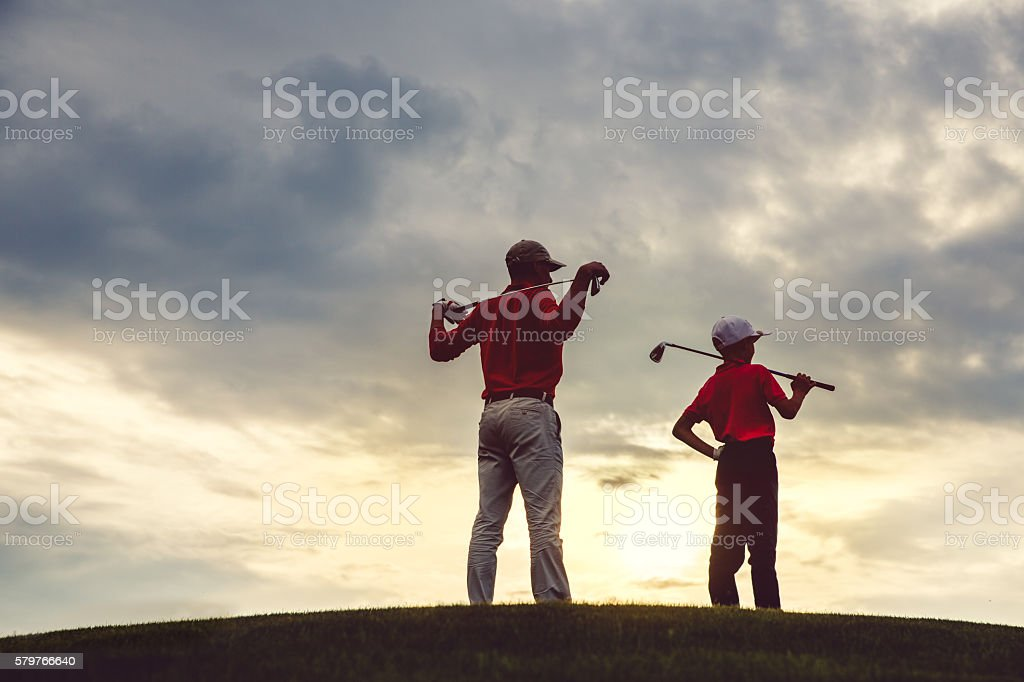 man with his son golfers stock photo
