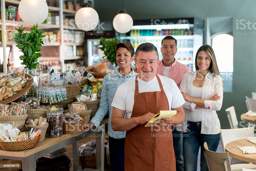 Man with his team working at the supermarket stock photo