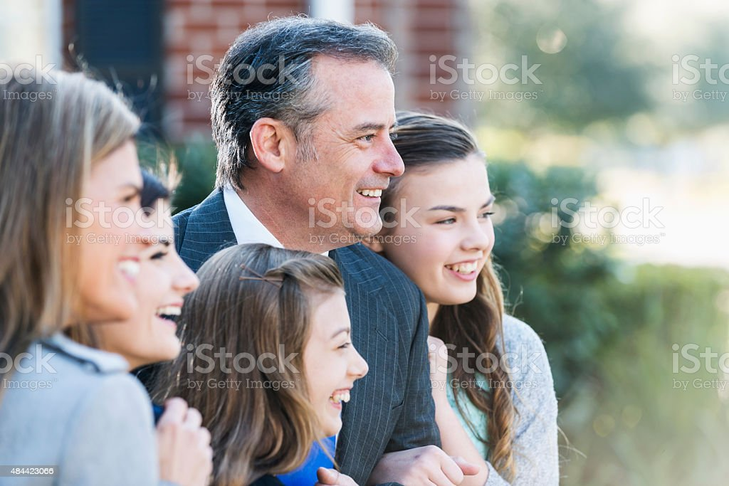 Man with his wife and three daughters stock photo