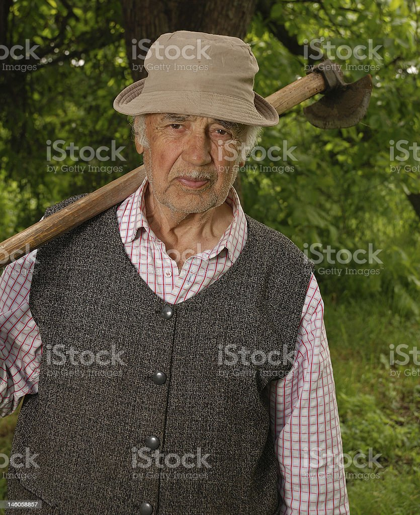 man with hoe stock photo