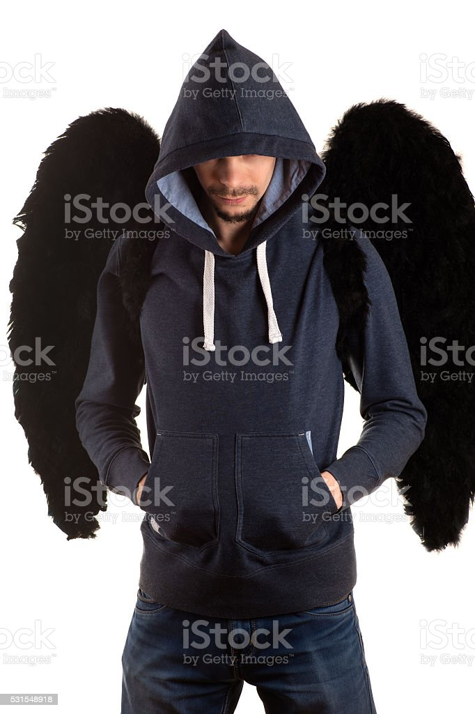 man with hood thrown standing and on back with black wings stock photo