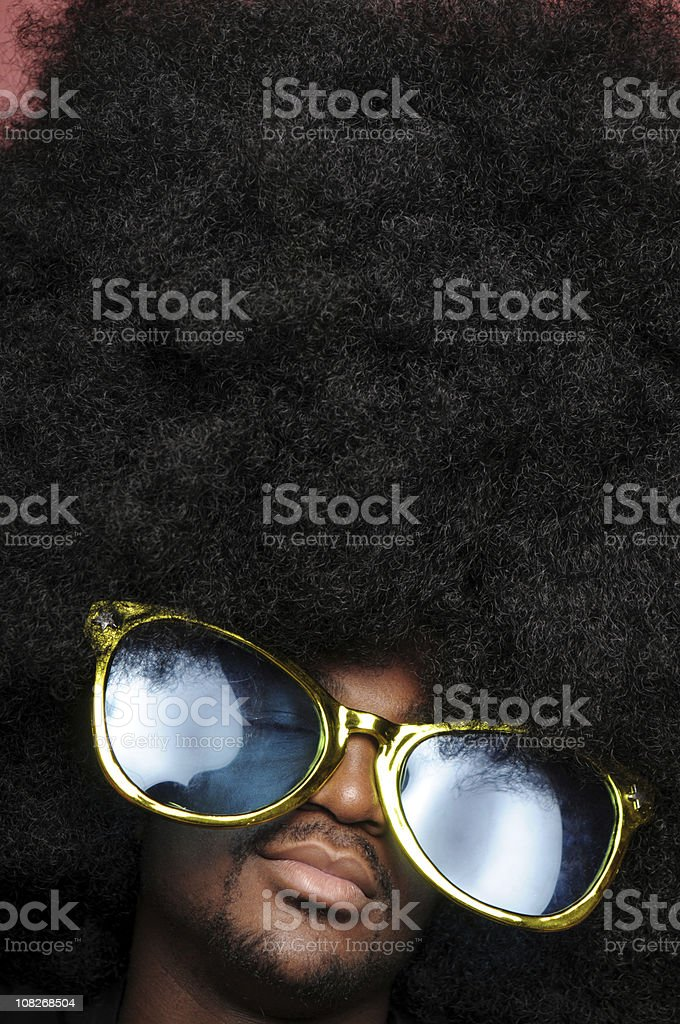 Man With Huge Afro Wearing Large Gold Sunglasses royalty-free stock photo