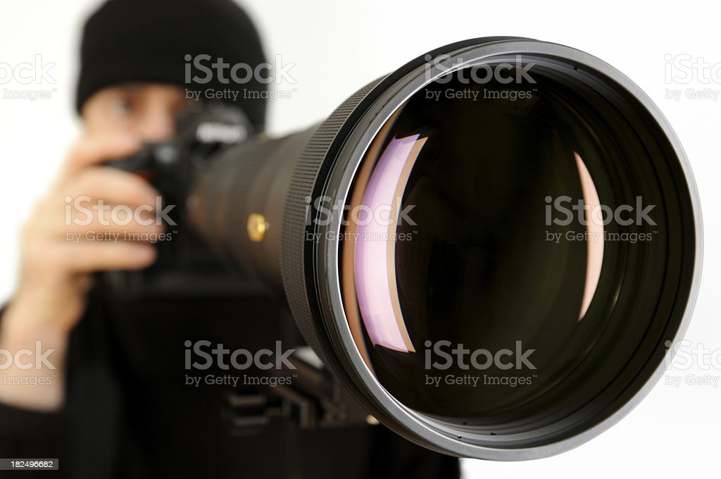 Man with Huge Telephoto Lens stock photo