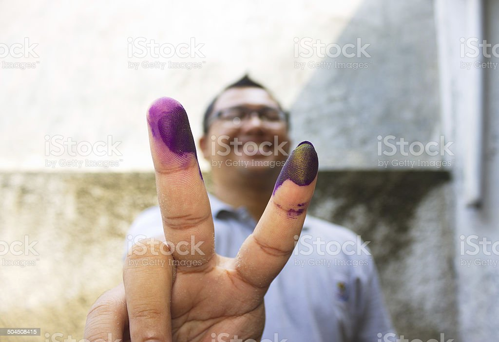 Man With Ink Marked Finger stock photo