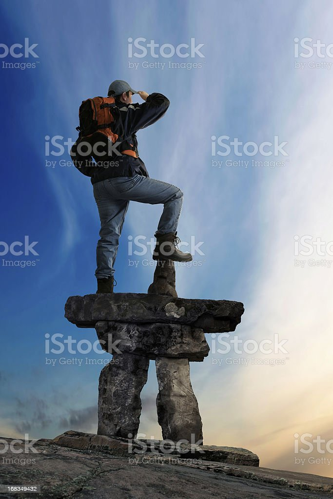 XXL man with inukshuk royalty-free stock photo