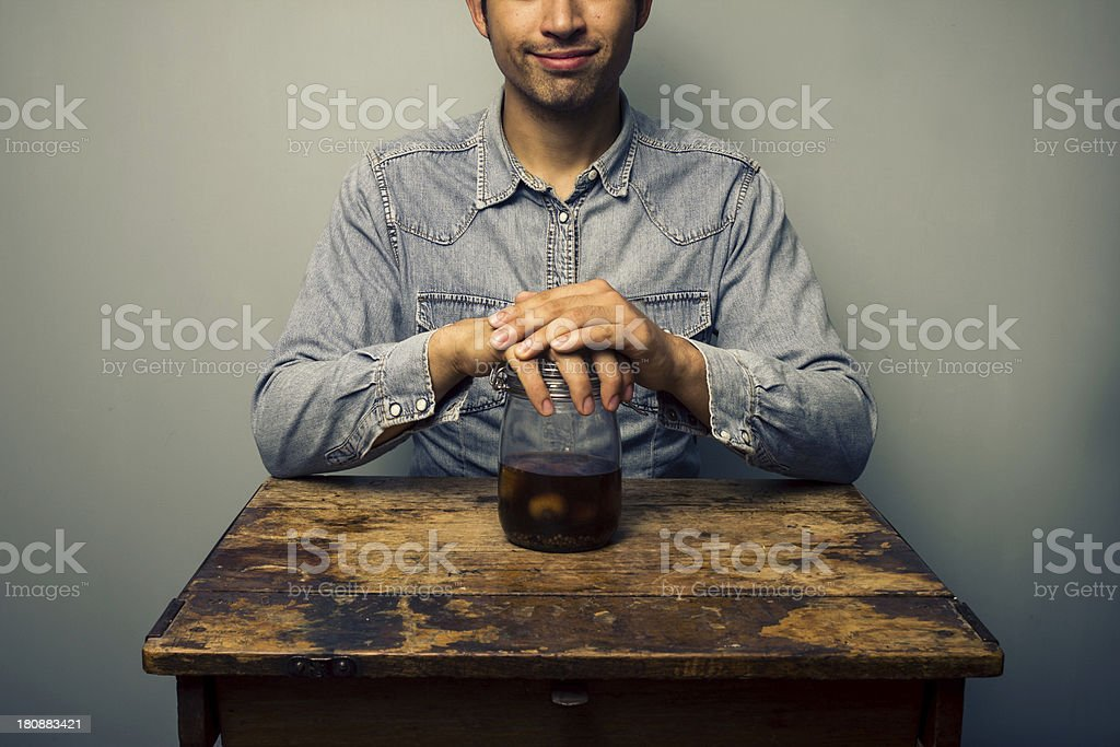 Man with jar of pickled onions at old desk royalty-free stock photo