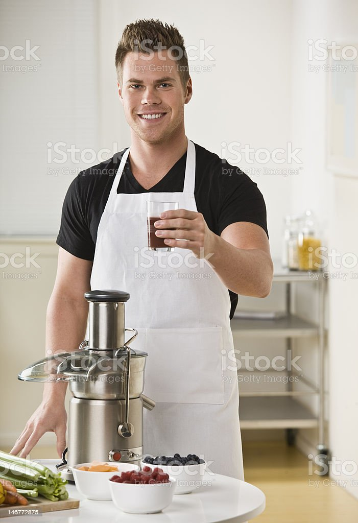Man With Juicer and Glass of Juice royalty-free stock photo
