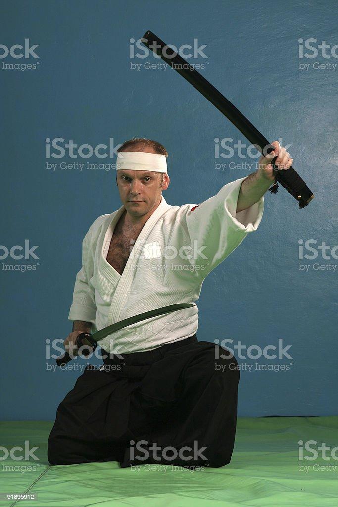 Man with katana(japanes sword) royalty-free stock photo