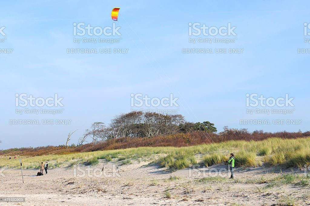 Man with Kite on beach of Baltic Sea Darss peninsulas stock photo