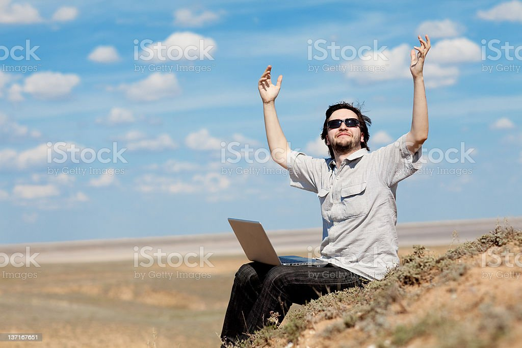 man with laptop outdoors royalty-free stock photo