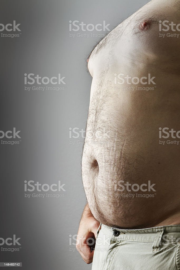 Man with large belly exposed stock photo