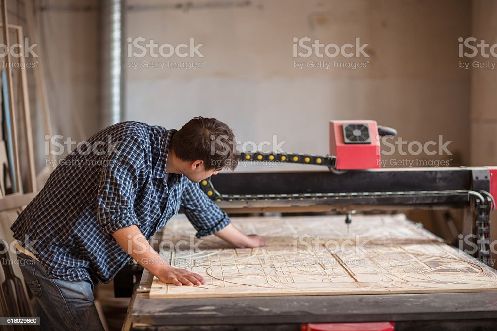 man with large CNC machine, lifestyle stock photo