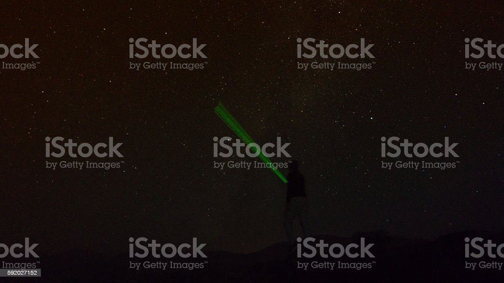 man with laser and Star field stock photo