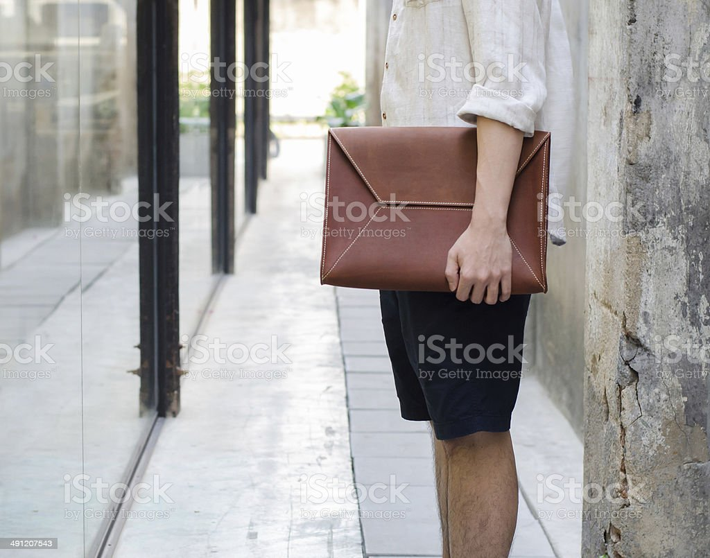 Man with leather bag stock photo