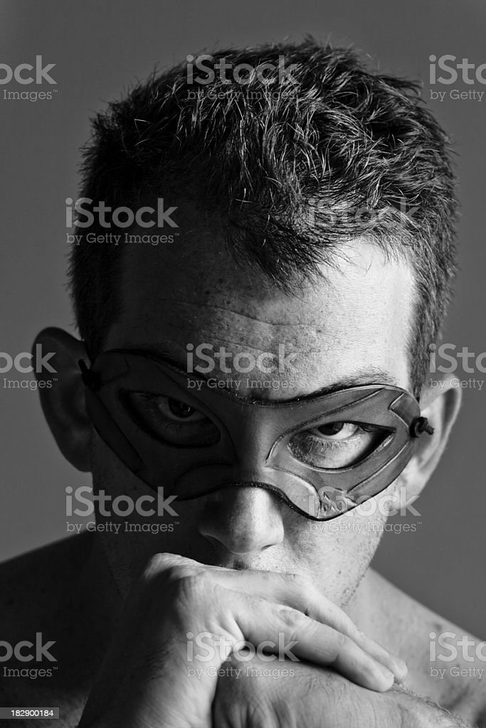 Man with Leather Mask in Thought royalty-free stock photo