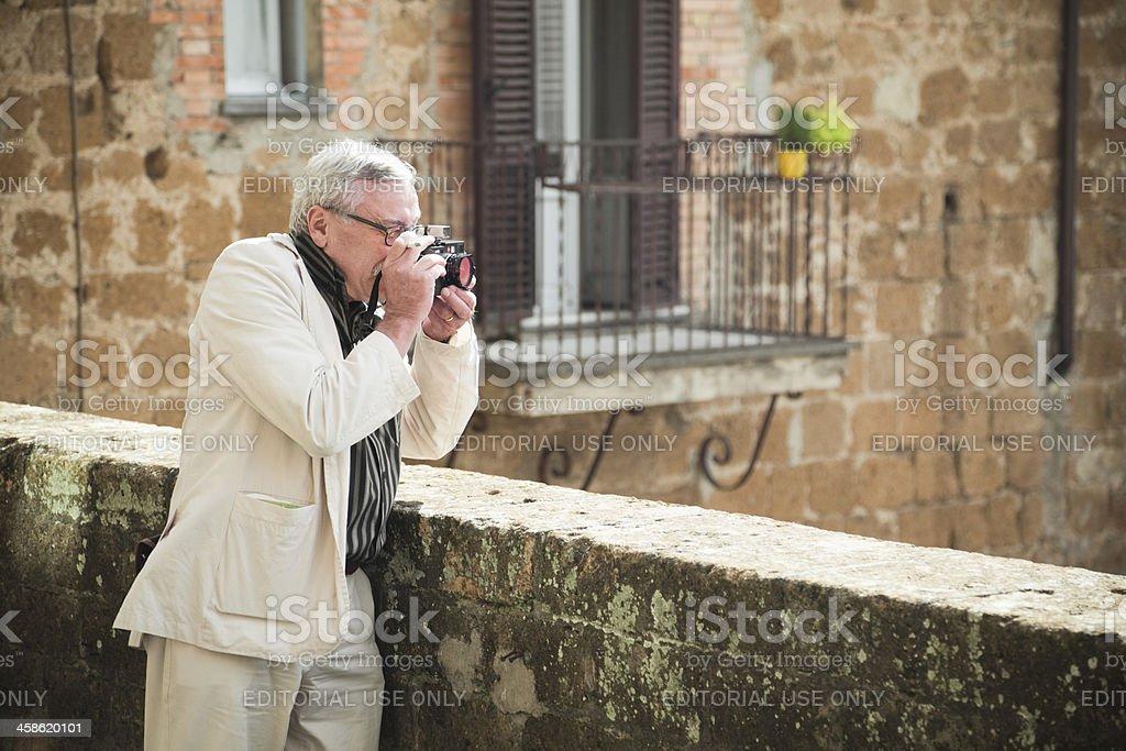 Man with Leica stock photo