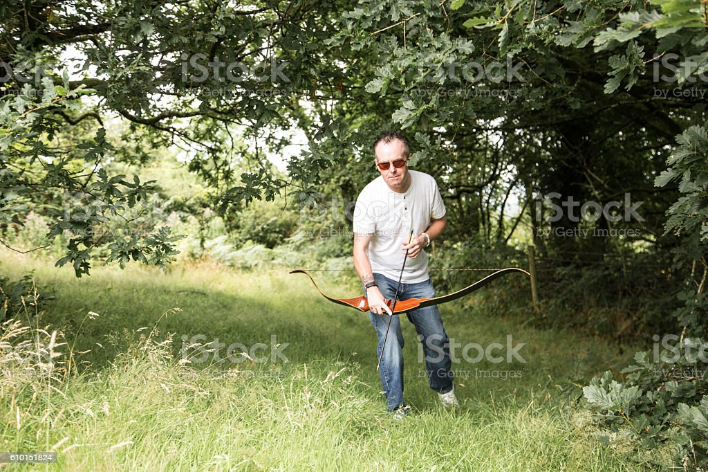 man with long bow stock photo