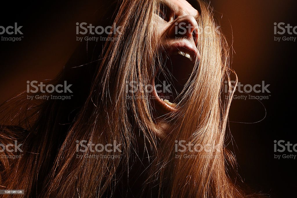Man with Long Hair Yelling royalty-free stock photo