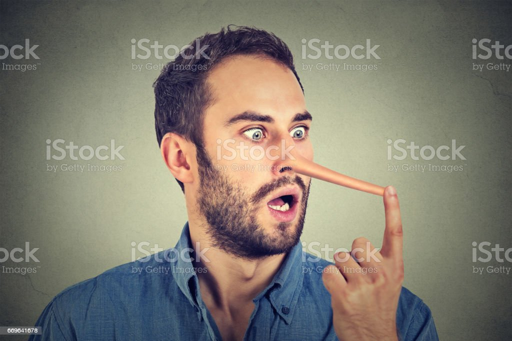 Man with long nose isolated on grey wall background. Liar concept stock photo