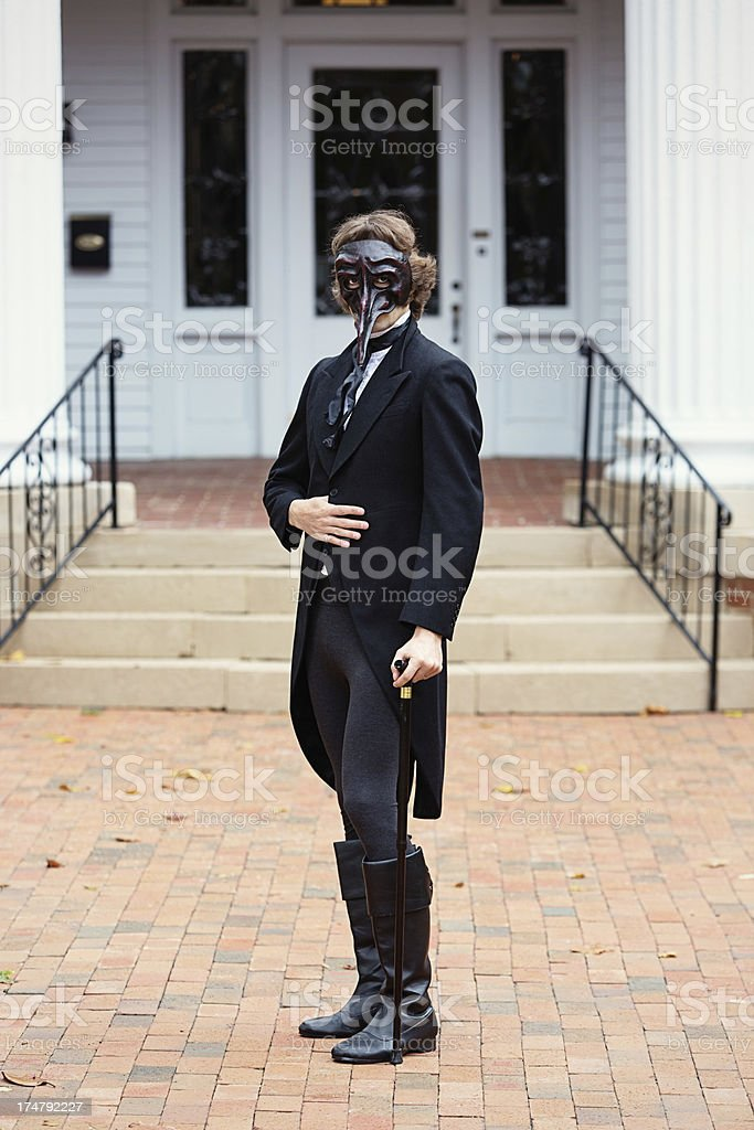 Man with long nosed wooden mask royalty-free stock photo