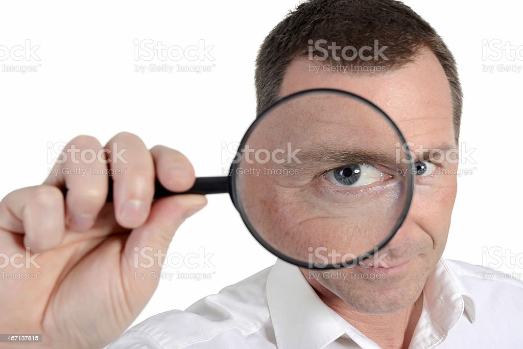 man with loupe stock photo
